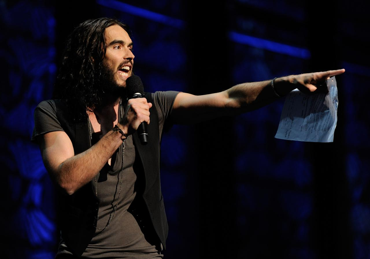 NEW YORK, NY - MARCH 04:  (EXCLUSIVE COVERAGE) Russell Brand speaks on stage during Amnesty International's Secret Policeman's Ball at Radio City Music Hall on March 4, 2012 in New York City.  (Photo by Kevin Mazur/Getty Images for Amnesty International)