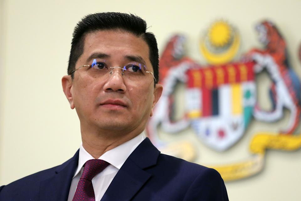 Malaysia's Minister of International Trade and Industry Azmin Ali reacts during a news conference in Putrajaya, Malaysia March 11, 2020. REUTERS/Lim Huey Teng