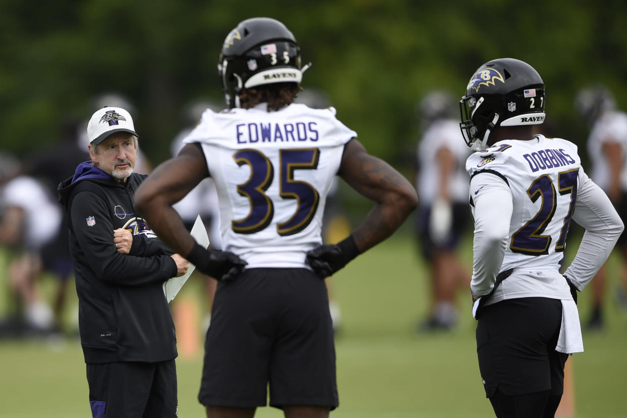 Baltimore Ravens running back coach Craig Ver Steeg, left, talks with running backs Gus Edwards and J.K. Dobbins during an NFL football practice, Monday, Aug. 16, 2021, in Owings Mills, Md.(AP Photo/Gail Burton)