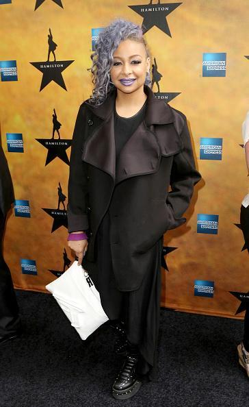 "<p>Raven-Symone, who's been co-hosting ""The View,"" matched her lilac hair, which is also shaved on one side, to her lips by wearing a purple lipstick. She kept the rest of her look (kind of) toned down in a trench coat and creeper shoes.</p>"