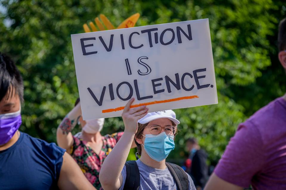 A participant holding a Eviction Is Violence sign at the protest.Tenants and Housing Activists gathered at Maria Hernandez Park for a rally and march in the streets of Bushwick, demanding the city administration to cancel rent immediately as the financial situation for many New Yorkers remains the same, strapped for cash and out of work. (Photo by Erik McGregor/LightRocket via Getty Images)