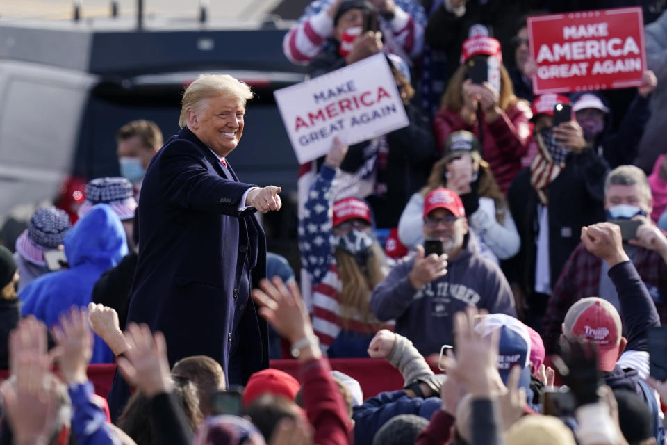 President Donald Trump points to supporters as he leaves a campaign rally at Manchester-Boston Regional Airport, Sunday, Oct. 25, 2020, in Londonderry, N.H. (AP Photo/Elise Amendola)