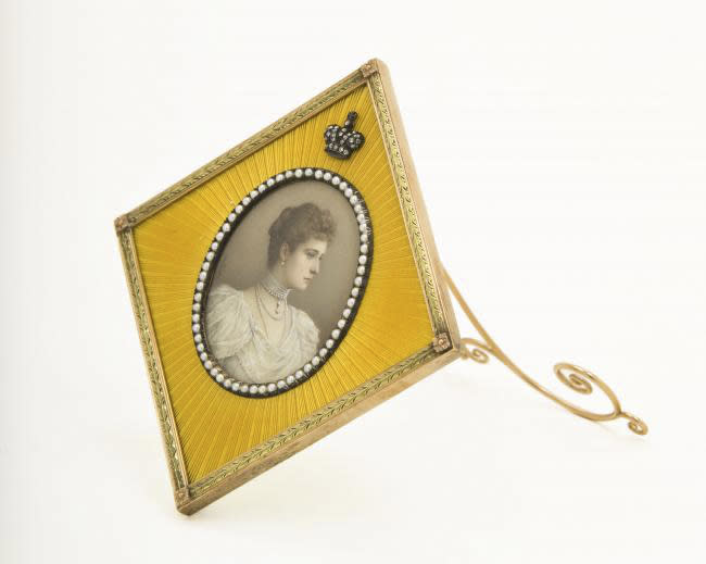 """An imperial presentation frame with a miniature portrait of Russian Tsarina Alexandra Feodorovna is shown in this undated photo from the Houston Museum of Natural Science. The piece is on display at the museum as part of the largest private collection in the United States of items from the Russian artisan Peter Carl Faberge. Featuring more than 350 objects, the exhibit """"Fabergé: A Brilliant Vision,"""" runs through Dec. 31, 2013 at the Houston Museum of Natural Science. (AP Photo/Houston Museum of Natural Science)"""