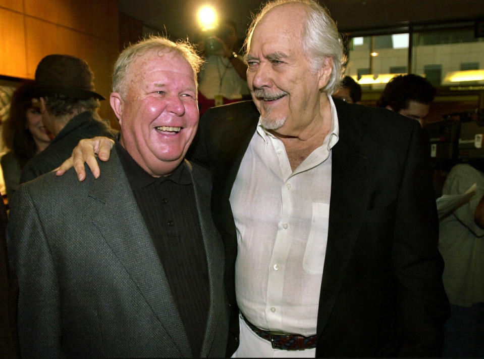 """FILE - In this Thursday, June 22, 2000, file photo, director-producer Robert Altman, right, laughs with actor Ned Beatty prior to the 25th anniversary screening of """"Nashville,"""" at the Academy of Motion Picture Arts and Sciences in Beverly Hills, Calif. Beatty portrayed Delbert Reese in Altman's film. Beatty, the indelible character actor whose first film role, as a genial vacationer raped by a backwoodsman in 1972′s """"Deliverance,"""" launched him on a long, prolific and accomplished career, died Sunday, June 13, 2021. He was 83. (AP Photo/Michael Caulfield, File)"""