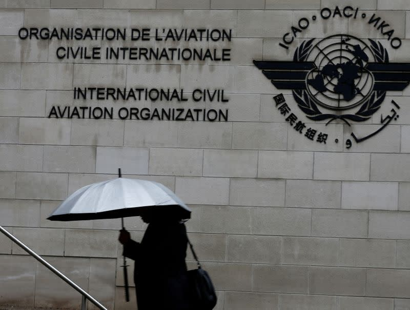 FILE PHOTO: A pedestrian walks past the International Civil Aviation Organization (ICAO) headquarters building in Montreal