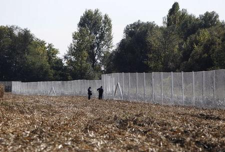A fence erected by Hungarian army soldiers is seen on the border with Croatia near Zakany