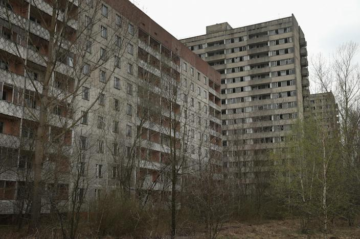 <p>Former apartment buildings stand abandoned in Pripyat, Ukraine (Getty Images) </p>