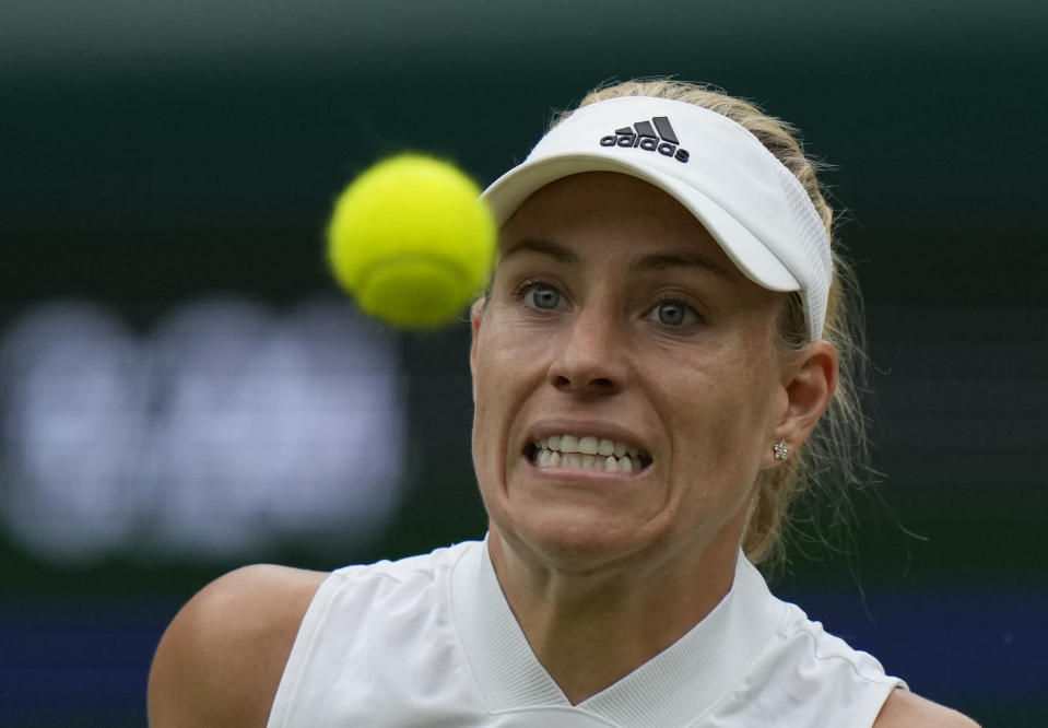 Germany's Angelique Kerber eyes the ball during the women's singles quarterfinals match against Czech Republic's Karolina Muchova on day eight of the Wimbledon Tennis Championships in London, Tuesday, July 6, 2021.(AP Photo/Alastair Grant)