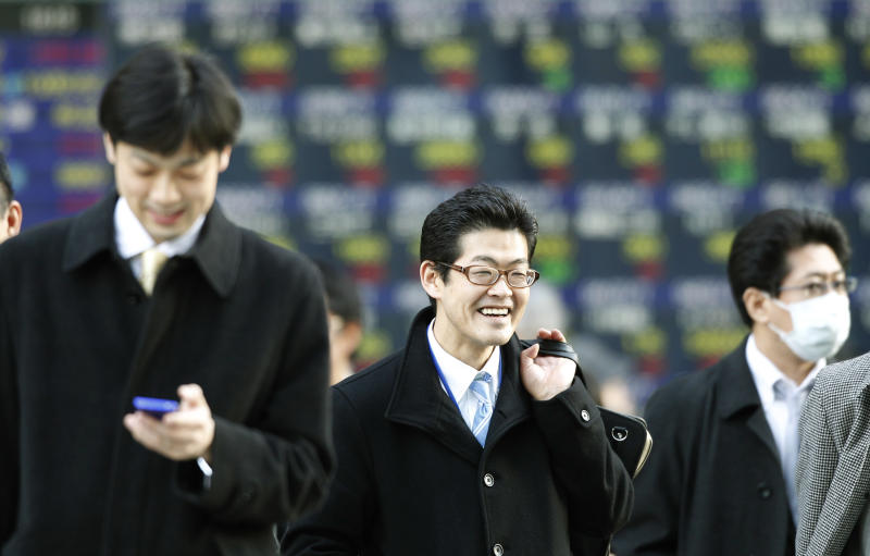 Men walk past an electronic stock indicator in Tokyo, Wednesday, March 14, 2012. Asian stock markets rose Wednesday, powered by the biggest gains of the year on Wall Street after the U.S. Federal Reserve said it expects unemployment in the world's largest economy to keep falling.   (AP Photo/Shizuo Kambayashi)
