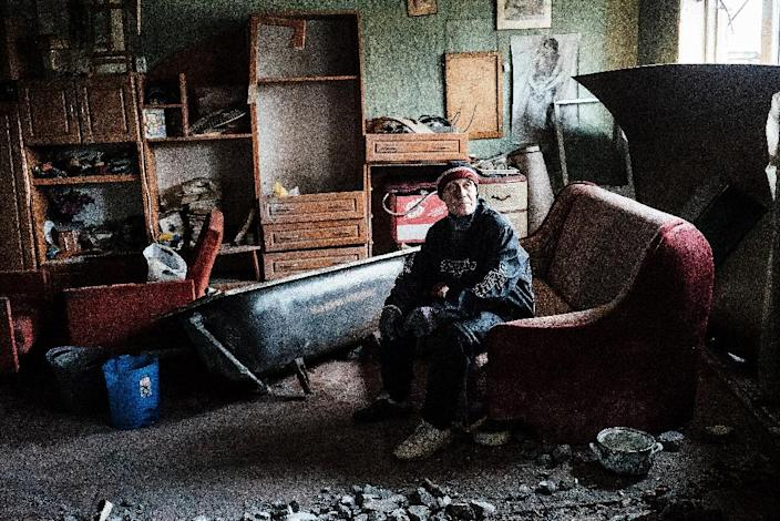 A Ukrainian man in his destroyed apartment in the Oktyabrsky district of the eastern city of Donetsk, on April 2, 2015 (AFP Photo/Dimitar Dilkoff)