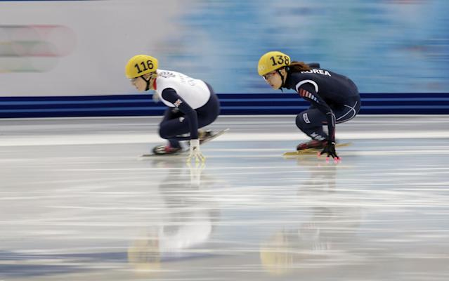 Elise Christie of Britain and Park Seung-hi of South Korea, right, compete in a women's 1000m short track speedskating quarterfinal at the Iceberg Skating Palace during the 2014 Winter Olympics, Friday, Feb. 21, 2014, in Sochi, Russia. (AP Photo/Bernat Armangue)