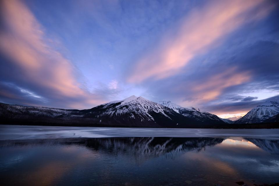 A snowy sunrise over Lake McDonald in Glacier National Park in Montana.