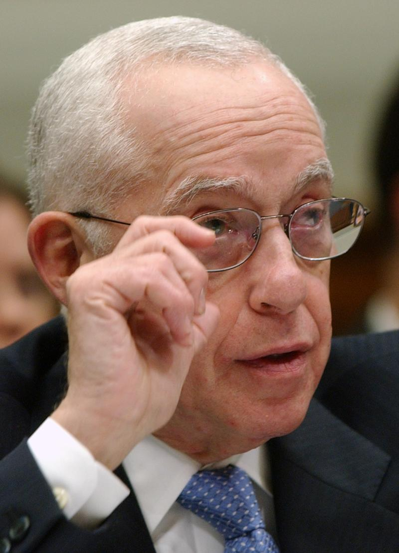FILE - In this Feb. 8, 2008, file photo, Attorney General Michael Mukasey testifies on Capitol Hill in Washington before the House Judiciary Committee. A briefing paper prepared for  Mukasey during the Bush administration in 2007 outlined failed attempts by federal agents to track illicitly purchased guns across the border into Mexico and stressed the need for U.S. and Mexican law enforcement officials to work together on such efforts using a tactic that now is generating controversy. (AP Photo/Dennis Cook, File)