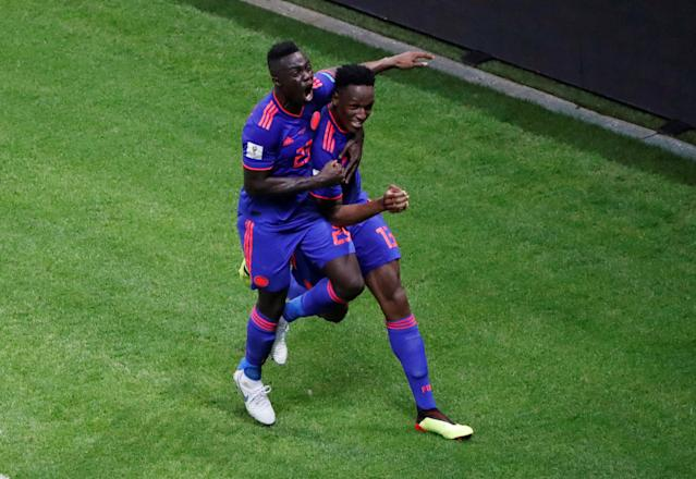 Soccer Football - World Cup - Group H - Poland vs Colombia - Kazan Arena, Kazan, Russia - June 24, 2018 Colombia's Yerry Mina celebrates scoring their first goal with Davinson Sanchez REUTERS/Jorge Silva