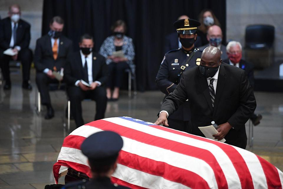 <p>John-Miles Lewis touches the casket of his father, the late Rep. John Lewis, D-GA, a key figure in the civil rights movement and a 17-term congressman from Georgia, lies in state in the Rotunda of the US Capitol in Washington, DC, on July 27, 2020.</p>