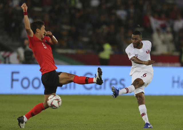 Qatar's midfielder Abdelaziz Hatem, right, kicks the ball in front of South Korea's midfielder Jung Woo-Young, left, as he scores his goal during the AFC Asian Cup quarterfinal soccer match between Korea Republic and Qatar at the Zayed Sport City Stadium in Abu Dhabi, United Arab Emirates, Friday, Jan. 25, 2019. (AP Photo/Kamran Jebreili)