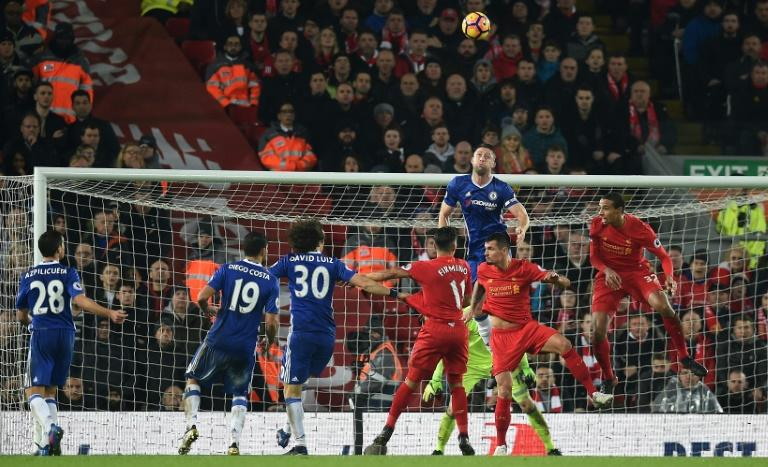 Chelsea's defender Gary Cahill (3R) jumps above Liverpool's defender Dejan Lovren (2R) as they vie for the ball during the English Premier League football match January 31, 2017