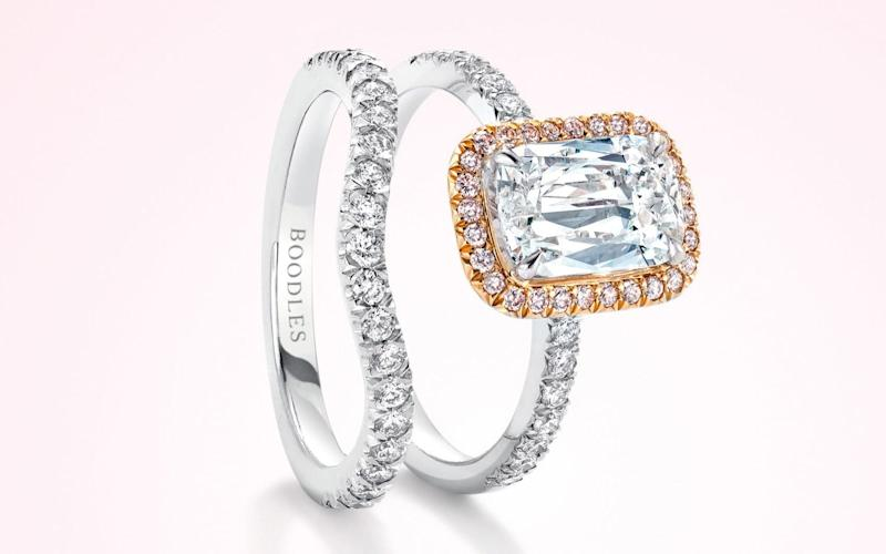 Boodles' vintage shaped half-hoop wedding band is curved to accommodate a large central stone, such as the Ashoka-cut diamond seen in this engagement ring