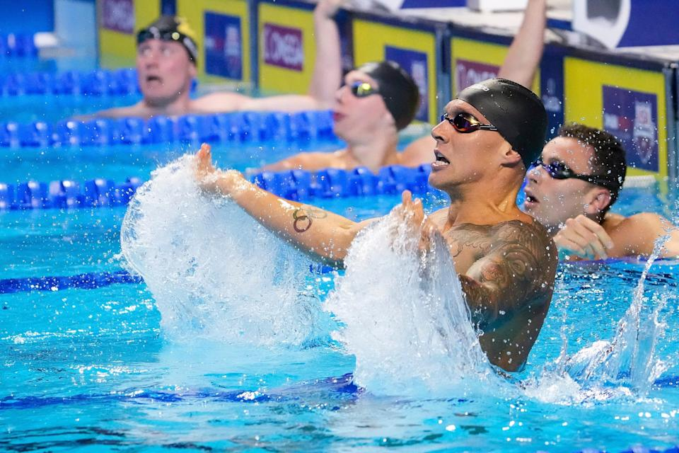 Caeleb Dressel reacts in the men's 100 freestyle Finals during the U.S. Olympic Team Trials Swimming competition at CHI Health Center Omaha.