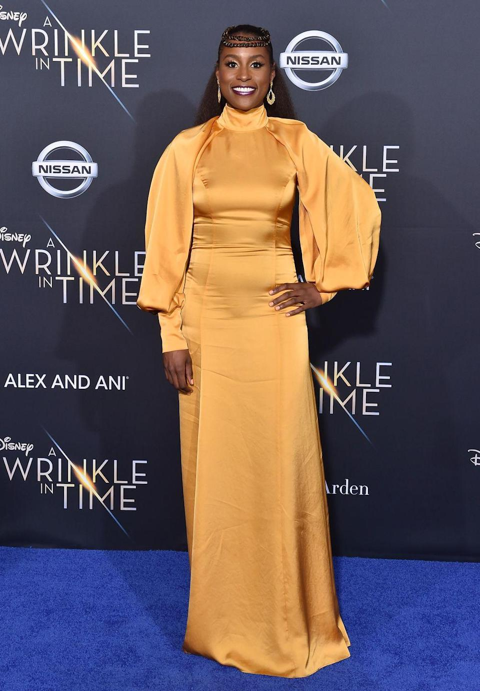 <p>Hey Queen: Turn your hair into a literal crown, singer <strong>Issa Rae</strong> style! Braid two sections of the top of hair, then wrap them around your head and pin in the shape of a crown, leaving the bottom strands flowing. </p>