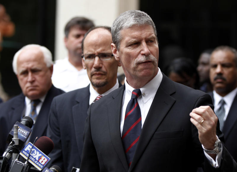 U.S. Attorney Jim Letten speaks outside Federal Court after sentences were handed out to five former New Orleans police in New Orleans, Wednesday, April 4, 2012. They were sentenced Wednesday to prison terms ranging from six to 65 years for their roles in deadly shootings of unarmed residents in the chaotic days after Hurricane Katrina.  Background center is Tom Perez, head of the civil rights division of the Justice Department,  and left is Dave Welker, special agent-in-charge for the F.B.I. in New Orleans. (AP Photo/Gerald Herbert)