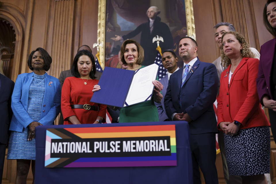 House Speaker Nancy Pelosi, D-Calif., joined by, from left, Rep. Val Demings, D-Fla., Rep. Stephanie Murphy, D-Fla., Rep. Darren Soto, D-Fla., and Rep. Debbie Wasserman Schultz, D-Fla., holds the bill to create the National Pulse Memorial to honor the victims of the 2016 mass shooting at the Pulse nightclub in Orlando, at the Capitol in Washington, Wednesday, June 16, 2021. The shooting was the deadliest attack on the LGBTQ community in U.S. history and left 49 people dead. (AP Photo/J. Scott Applewhite)