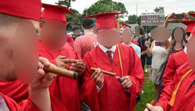 Seven players were suspended from postseason play after smoking cigars at Saugus High graduation. (via @wbz on Twitter)