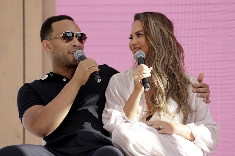 CANNES, FRANCE - JUNE 18: Chrissy Teigen and John Legend go behind the Tweets at #TwitterBeach at Cannes Lions on June 18, 2019 in Cannes, France. (Photo by Xavi Torrent/Getty Images for Twitter)