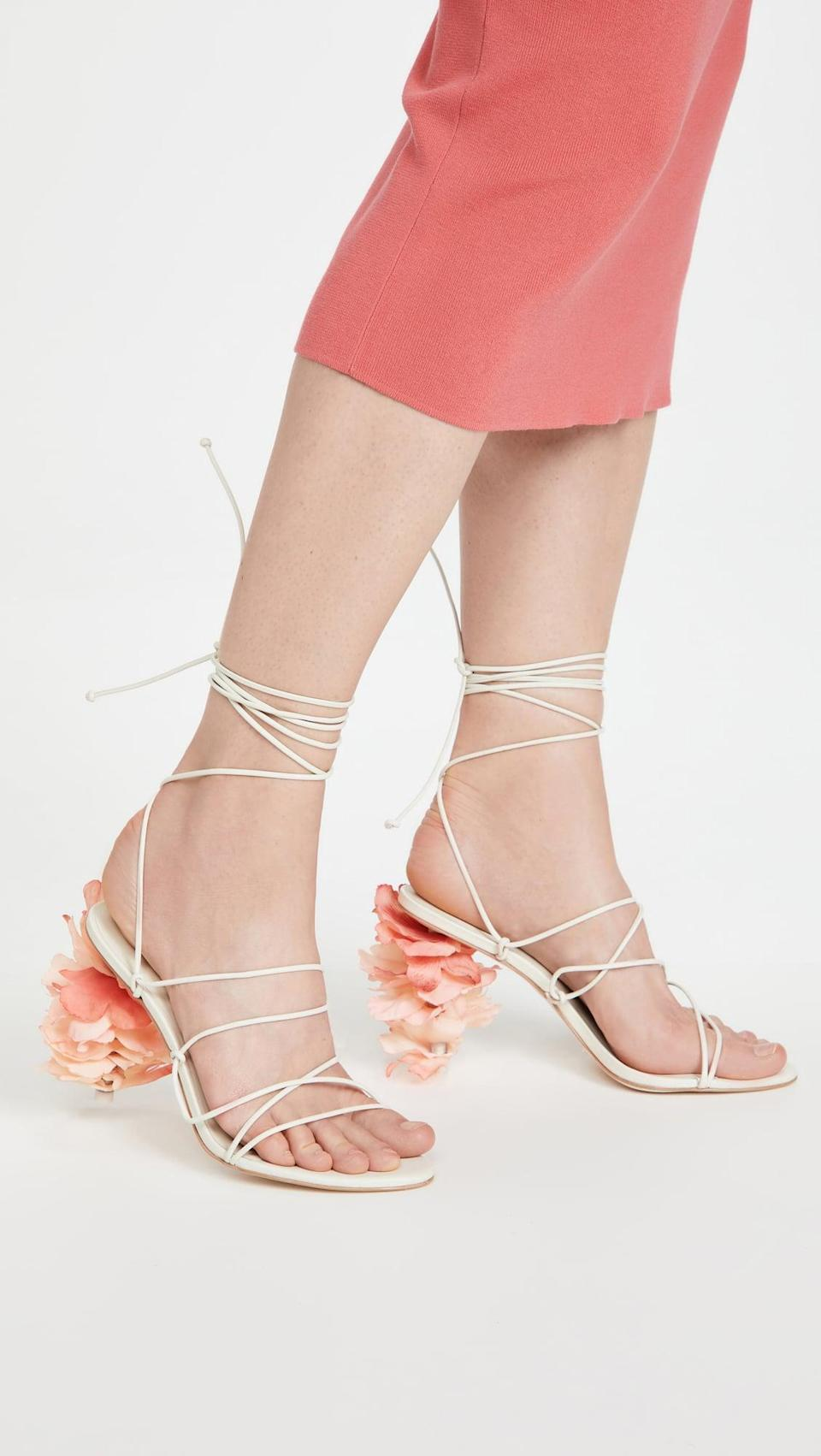 <p>These <span>Cult Gaia Effie Sandals</span> ($498) are so cool. We love the thin white straps that go up the leg, and the flower petal heels are next level pretty.</p>