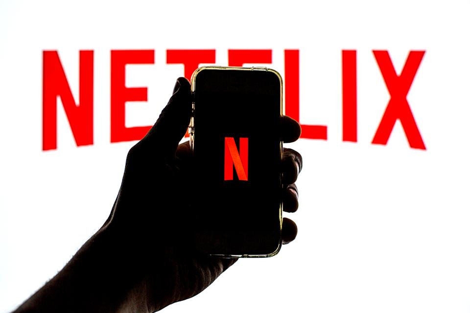 SPAIN - 2021/03/23: In this photo illustration the Netflix App seen displayed on a smartphone screen with the Netflix logo in the background. (Photo Illustration by Thiago Prudêncio/SOPA Images/LightRocket via Getty Images)