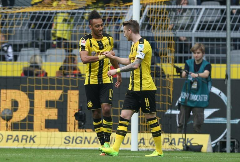 Dortmund's forward Pierre-Emerick Aubameyang (L) celebrate scoring the 2-0 goal with Dortmund's forward Marco Reus during the German First division Bundesliga football match between Borussia Dortmund and Bayer 04 Leverkusen on March 4, 2017