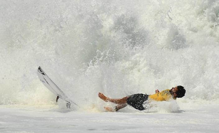 A surfer bails out of a wave in the ISA World Surfing Games at Surf City in El Salvador.