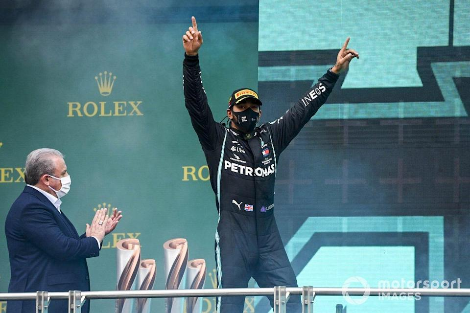 "Lewis Hamilton, Mercedes-AMG F1, 1st position, arrives on the podium after securing his seventh world drivers championship title<span class=""copyright"">Mark Sutton / Motorsport Images</span>"