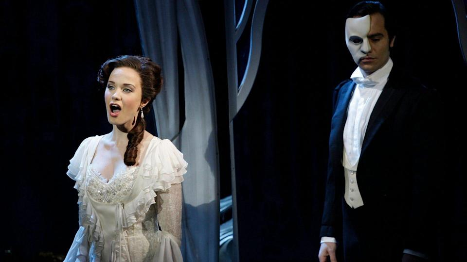 """Mandatory Credit: Photo by Joel Ryan/AP/Shutterstock (7033229b)Ramin Karimloo, Sierra Boggess The Phantom, played by Ramin Karimloo, right, performs a scene with Christine, played by Sierra Boggess, from the sequel to The Phantom of the Opera, """"Love Never Dies"""" at the Adelphi Theatre in central London."""