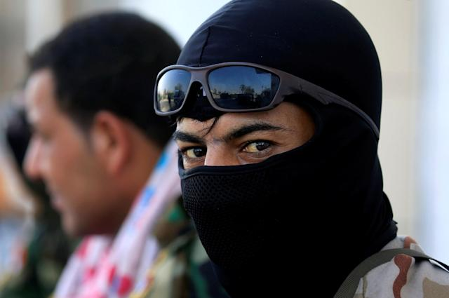<p>A member of the Iraqi security forces looks on near the building of the government office in Basra, Iraq, Sept. 5, 2018. (Photo: Alaa al-Marjani/Reuters) </p>