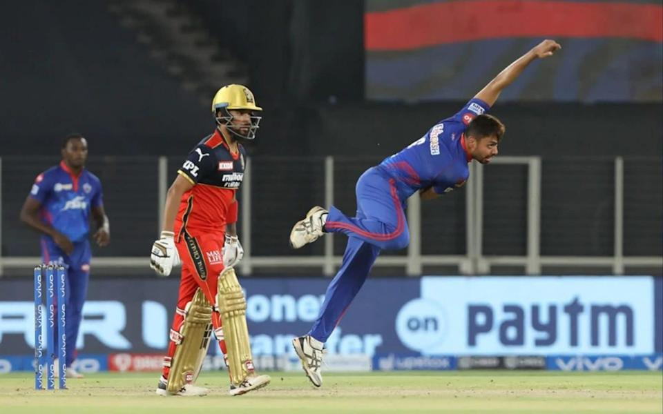 Avesh Khan of the Delhi Capitals bowling against the Royal Challengers Bangalore last month - SPORTZPICS