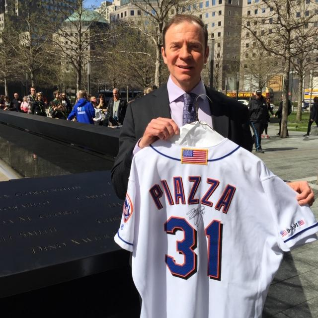 Ken Goldin at the 9/11 Memorial in New York City in April 2016, displaying jersey worn by Mike Piazza in the first Mets home game after 9/11. (Credit: Ken Goldin)