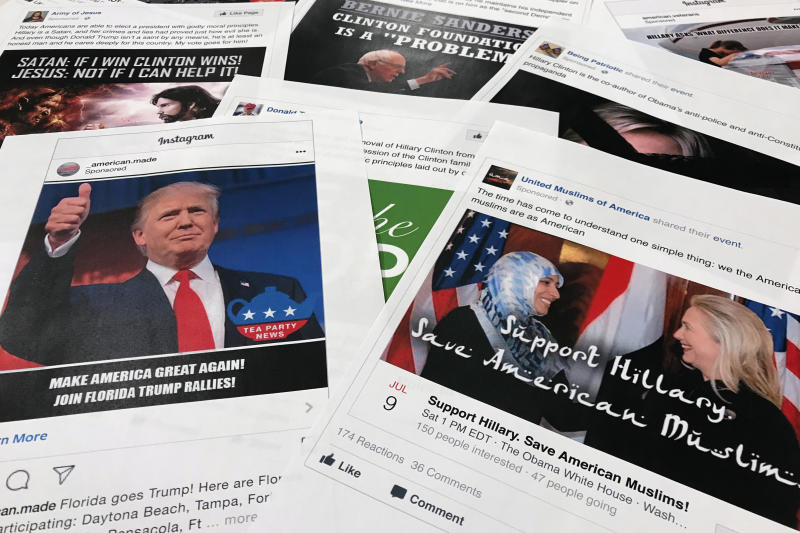 FILE - In this Nov. 1, 2017, file photo, Some of the Facebook and Instagram ads linked to a Russian effort to disrupt the American political process and stir up tensions around divisive social issues, released by members of the U.S. House Intelligence committee, are photographed in Washington. Russia's interference in the 2016 U.S. election has generally been seen as two separate, unrelated tracks: hacking Democratic emails and sending provocative tweets. But a new study suggests the tactics were likely intertwined. On the eve of the release of hacked Clinton campaign emails, Russian-linked trolls retweeted messages from thousands of accounts on both extremes of the American ideological spectrum. (AP Photo/Jon Elswick, File)