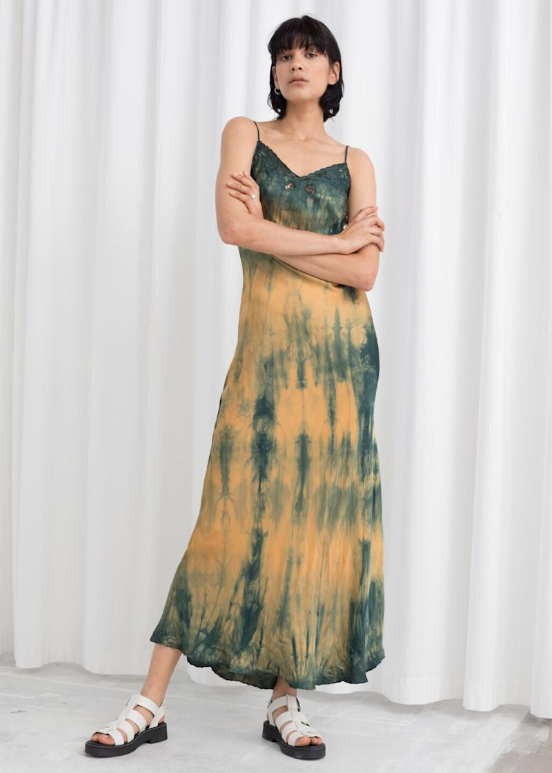 "<strong><a href=""https://www.stories.com/en_usd/clothing/dresses/maxi-dresses/product.tie-dye-midi-slip-dress-yellow.0750407001.html"" target=""_blank"" rel=""noopener noreferrer"">Get the &amp; Other Stories tie-dye slip dress for $129.</a></strong>"