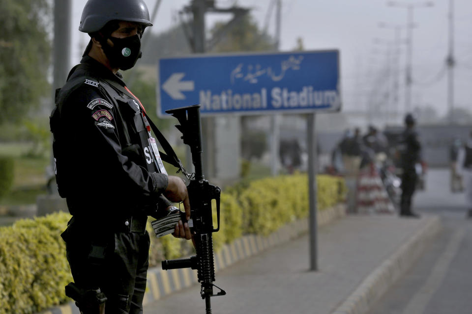 Police commando stands guard on the arrival of South Africa's cricket team for a practice session at the National Cricket Stadium, in Karachi, Pakistan, Saturday, Jan. 23, 2021. South Africa, which arrived in the southern port city of Karachi for the first time in nearly 14 years, will play the first test match against Pakistan starting on Jan. 26. (AP Photo/Fareed Khan)
