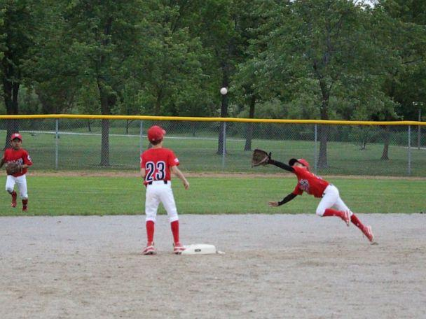 PHOTO: Ashlynn Theiren makes a diving catch playing baseball for the Whitby Chiefs. (Ryan Murdoch)