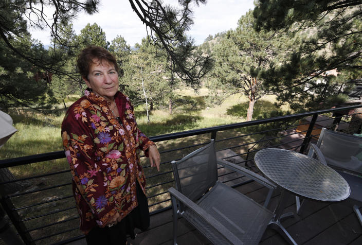 Dr. Barbara Morris is shown outside her home Wednesday, Sept. 4, 2019, in Golden, Colo. Morris has joined forces with her former cancer patient, Neil Mahoney, to say that a Colorado hospital's policy barring the doctor from administering life-ending drugs to Mahoney at his home goes against the state's assisted suicide law. (AP Photo/David Zalubowski)