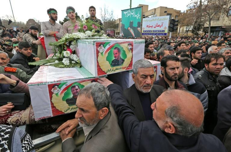 """Tens of thousands chanted """"down with America"""" and """"we will never submit"""" at the funeral of Revolutionary Guards killed in Wednesday's attack by a jihadist group Tehran accuses Pakistan of supporting"""
