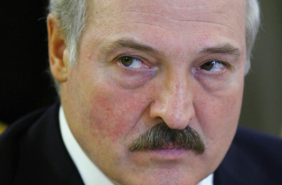 FILE - In this March 19, 2012, file photo, Belarus President Alexender Lukashenko looks at the media in the Grand Kremlin Palace at the start of the Euro Asian Economic Union summit, a Russia-dominated economic alliance, in Moscow, Russia. When Lukashenko became president in 1994, Belarus was an obscure country that had not even existed for three years. Over the next quarter-century, he brought it to the world's notice via dramatic repression, erratic behavior and colorful threats. (AP Photo/File)