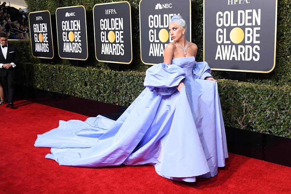 """<p><a rel=""""nofollow noopener"""" href=""""https://www.popsugar.com/fashion/Lady-Gaga-Honoring-Judy-Garland-2019-Golden-Globes-45646563"""" target=""""_blank"""" data-ylk=""""slk:Paying tribute to Judy Garland"""" class=""""link rapid-noclick-resp"""">Paying tribute to Judy Garland</a> in a <a rel=""""nofollow noopener"""" href=""""https://www.popsugar.com/fashion/Lady-Gaga-Dress-Golden-Globes-2019-45646226"""" target=""""_blank"""" data-ylk=""""slk:Valentino gown"""" class=""""link rapid-noclick-resp"""">Valentino gown</a>, Giuseppe Zanotti shoes, and Tiffany & Co. jewels.</p>"""