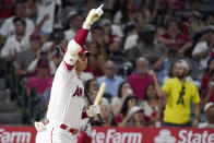 Los Angeles Angels designated hitter Shohei Ohtani gestures to David Fletcher as Fletcher advances to second on a wild pitch during the eighth inning of a baseball game against the Seattle Mariners Friday, July 16, 2021, in Anaheim, Calif. (AP Photo/Mark J. Terrill)