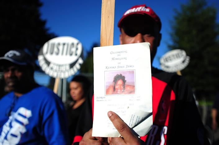 """Portland police Officer Scott McCollister fatally shot Kendra James during a traffic stop. When McCollister pulled over the car in which James was a passenger, he took the driver, Terry Jackson, into custody after seeing he had an outstanding warrant. James moved behind the wheel of the car and tried to drive away, and McCollister tried to stop her by climbing partway&nbsp;into the car and <a href=""""http://www.portlandoregon.gov/police/article/33708"""" rel=""""nofollow noopener"""" target=""""_blank"""" data-ylk=""""slk:pulling her hair and using pepper spray and a Taser"""" class=""""link rapid-noclick-resp"""">pulling her hair and using pepper spray and a Taser</a>. James put the car into drive and McCollister shot her. He later claimed he'd gotten stuck in the car's doorway and that he'd feared for his life.<br><br>A grand jury declined to prosecute. McCollister&nbsp;was <a href=""""http://www.oregonlive.com/portland/index.ssf/2013/04/memorial_planned_to_mark_10-ye.html"""" rel=""""nofollow noopener"""" target=""""_blank"""" data-ylk=""""slk:initially suspended"""" class=""""link rapid-noclick-resp"""">initially suspended</a>, but the disciplinary action was overturned by an arbitrator.<br><br>&ldquo;It&rsquo;s been 10 years later, justice has still not [been] served,&rdquo; James&rsquo; mother, Shirley Isadore,&nbsp;<a href=""""http://koin.com/2013/05/05/kendra-james-remembered-at-portland-rally/"""" rel=""""nofollow noopener"""" target=""""_blank"""" data-ylk=""""slk:said at a 2013 rally"""" class=""""link rapid-noclick-resp"""">said at a 2013 rally</a> marking the anniversary of her daughter&rsquo;s death."""