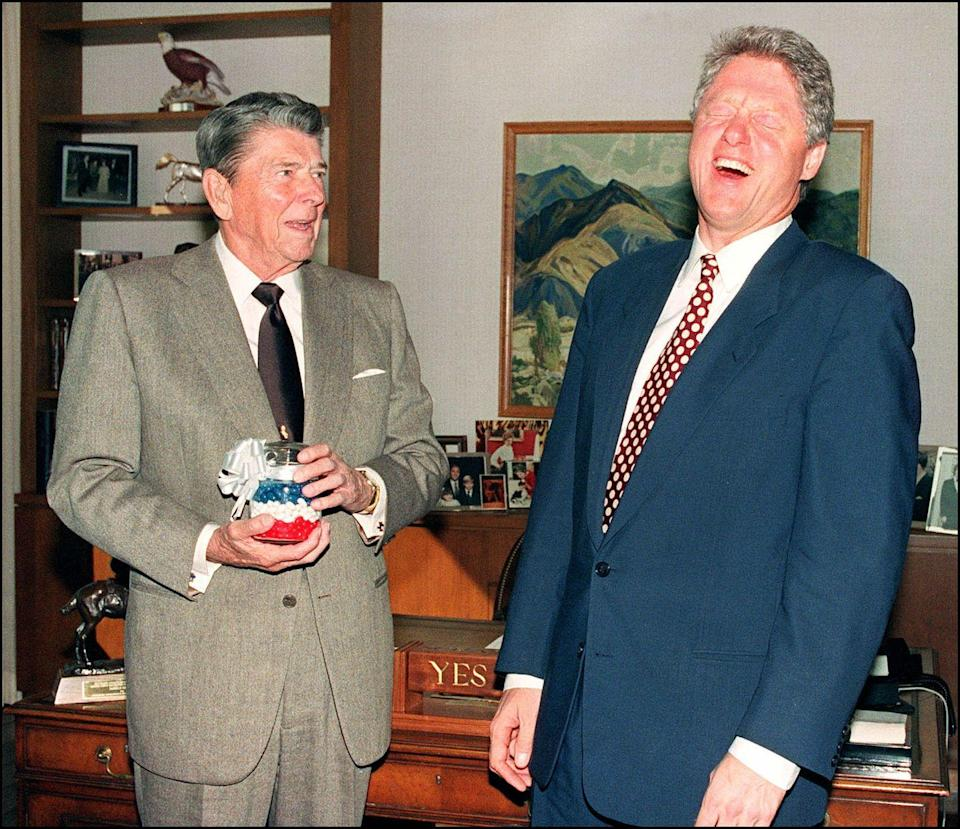"""<p>President Reagan <a href=""""https://www.reaganlibrary.gov/reagans/ronald-reagan/jelly-bellyr-jelly-beans-and-ronald-reagan"""" rel=""""nofollow noopener"""" target=""""_blank"""" data-ylk=""""slk:was a big fan of jelly beans,"""" class=""""link rapid-noclick-resp"""">was a big fan of jelly beans,</a> so much so that the Jelly Belly company provided him with a stock while he was in office. During their transition of power, President Reagan gifted then President-elect Clinton with some patriotic sweets of his own. </p>"""