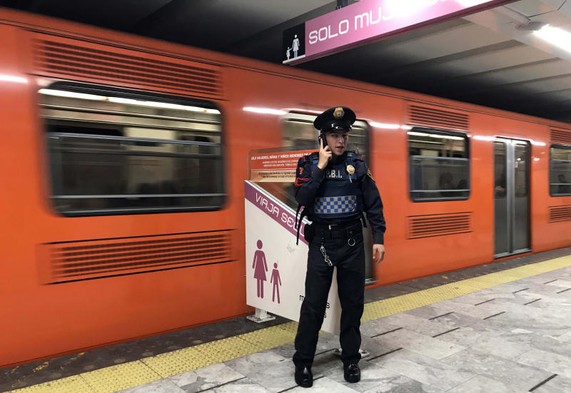 A police officer stands guard at an exclusive boarding area for women and children under twelve years old, at Pino Suarez subway station in Mexico City on February 07, 2019. - Along with the violence linked to drug trafficking, femicides in Mexico have been increasing. According to the UN, nine women are killed every day in Mexico, and six out of ten have faced some kind of aggression, many of them in public transport. (Photo by ALFREDO ESTRELLA / AFP) (Photo credit should read ALFREDO ESTRELLA/AFP via Getty Images)