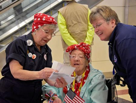 "The Army Engineer Spouses Club welcome a group of more than 30 Michigan-based ""Rosie the Riveters"" at Ronald Reagan International Airport in Arlington, Virginia, U.S., March 22, 2016. Cynthia Mitchell/U.S. Army Corps of Engineers, Baltimore District/Handout via REUTERS"